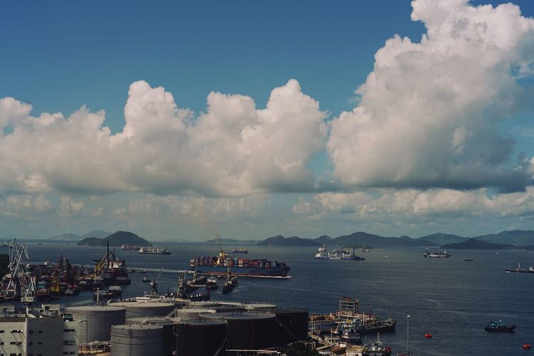 Cloud - Sky Sky Nautical Vessel Transportation Sea Water Outdoors Day Hong Kong Tim Wong Sony Harbor No People Freight Transportation Commercial Dock Building Exterior Cityscape Architecture Nature Cargo Container Beauty In Nature Sailing