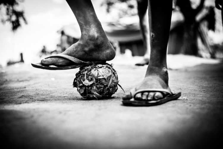 Slippers Unrecognizable Person Monochrome Leicacamera Soccer Ball Soccer Player Leisure Activity Human Foot Close-up Human Leg Selective Focus Human Body Part Low Section Improvised Ball Sustainable Resources Sustainable Lifestyle Rubbish Ball Makeshift Football Selfmade Soccer Ball Soccer In Poor Countries No Gadgets Toys Out Of Junk The Week on EyeEm