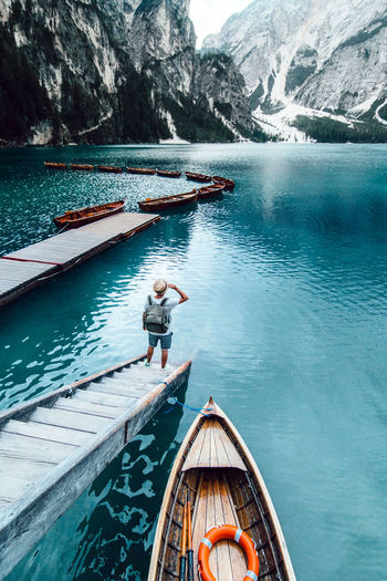 Man in boat on lake against mountain