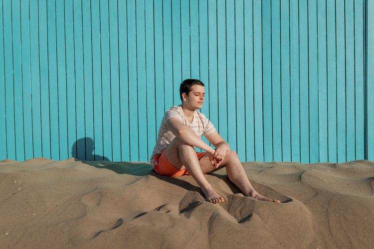 Portrait of boy sitting on beach