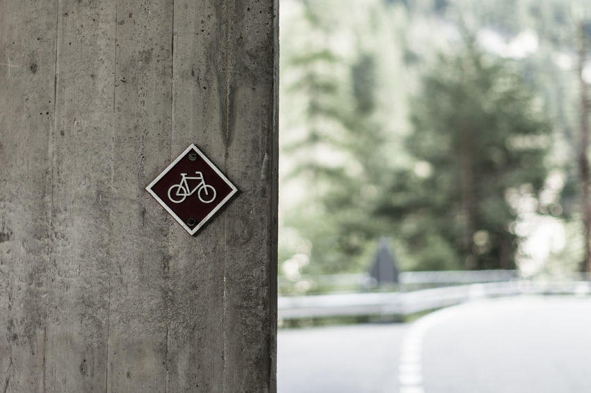 Bicycle Sign on Concrete Wall / (c) Nidal Sadeq Copy Space EyeEm Best Shots Pictogram Textures And Surfaces Bicycle Rack Bike Path Bike Way Bikeway Close-up Communication Concrete Jungle Concrete Wall Danger Day Focus On Foreground Grey Guidance No People Outdoors Road Sign Street Sign Streetphotography Text Tree Warning Sign