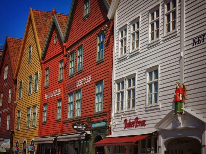 Bergen Houses Norway Architecture Building Building Exterior Built Structure City Commercial Sign Communication Day Housefront Information Low Angle View Nature No People Outdoors Residential District Row House Sign Sky Street Text Western Script Window
