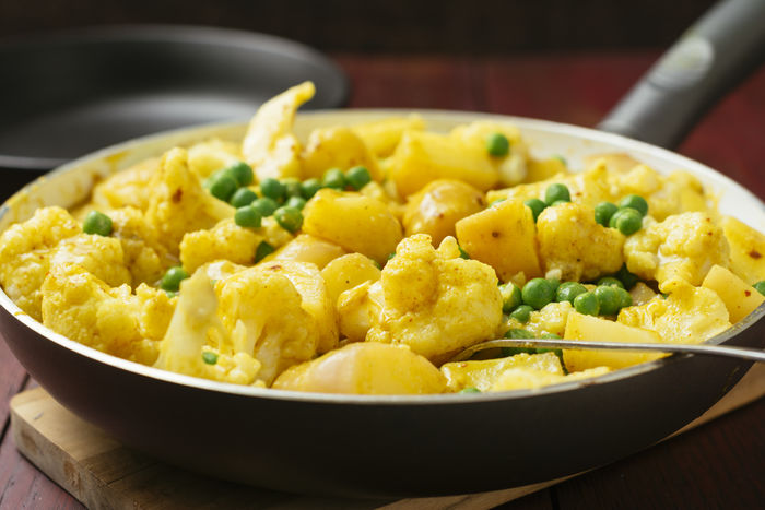 Cauliflower, Pea and Potato Curry being served Curry Indian Meal Potato Vegetarian Vegetarian Food Bowl Cauliflower Close-up Food Food And Drink Freshness Healthy Eating Indian Food Indish Food Indoors  No People Pan Peas Ready-to-eat Serve Serving Table Vegan Food Vegetable