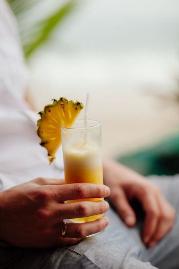 Close-up of man hand holding drink