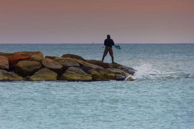 Rock Formation Day Fisherman Lifestyles Outdoor Photography Outdoors Sea And Sky