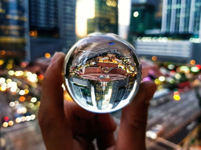 R E A L I T Y - G E M Focus On Foreground Close-up Reflection Shiny One Person Built Structure Real People Day Outdoors Architecture Illuminated City Bubble Wand People Lensball first eyeem photo