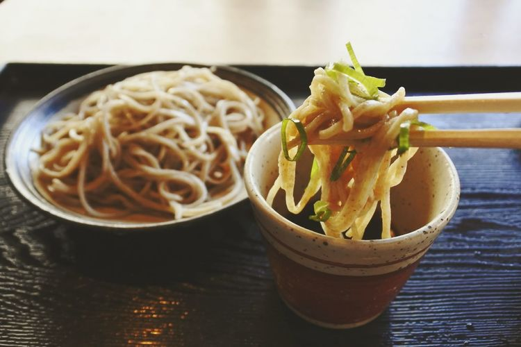 Close-Up Of Chopsticks Holding Noodles