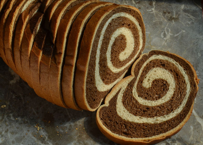High angle view of sliced marble rye bread on table