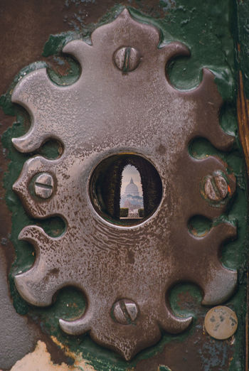 St peter's basilica in rome through a keyhole Metal Close-up No People Pattern Day Old Rusty Hole Circle Shape Face Detail Geometric Shape Anthropomorphic Face Outdoors Weathered Anthropomorphic Wall - Building Feature Architecture Design Vatican Cathedral Keyhole
