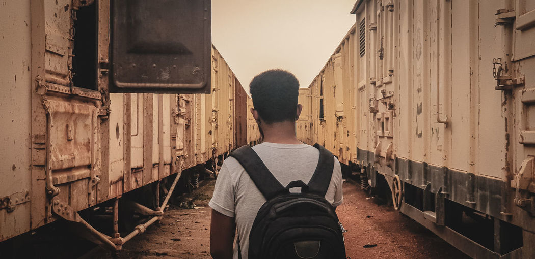 Rear view of man standing on train