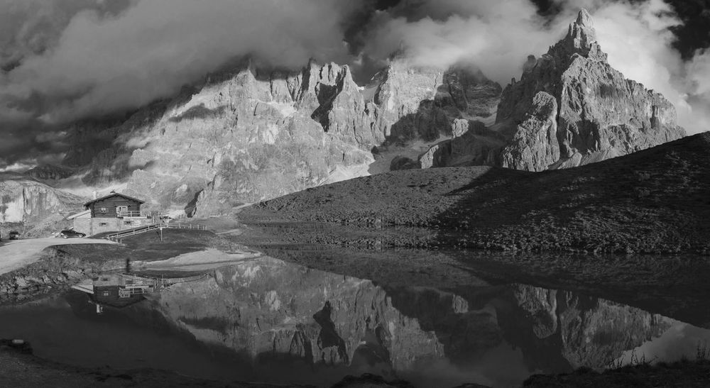 Baita Segantini Black And White Chalet Clouds Day Dolomites Dolomiti Geology Italy Lake Landscape Mirror Mountain Mountain Range Nature No People Pale Di San Martino Physical Geography San Martino Di Castrozza Sky Water The Great Outdoors - 2017 EyeEm Awards Lost In The Landscape Black And White Friday