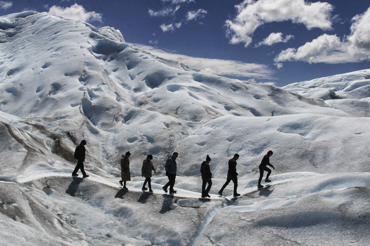 Snow Group Of People Winter Cold Temperature Sky Cloud - Sky Leisure Activity Real People Sport Mountain Beauty In Nature Winter Sport Nature Scenics - Nature Lifestyles Men People Day Adventure Snowcapped Mountain Mountain Range Warm Clothing Outdoors Glacier Perito Moreno. Patagonia. Argentina.