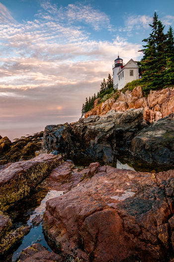 Lighthouse Acadianationalpark Bass Harbor Lighthouse Beauty In Nature Building Exterior Built Structure Cliff Cloud - Sky Lighthouse Maine Nature No People Outdoors Rocky Coastline Scenics Sea Sky Sunrise Vertical Composition Water