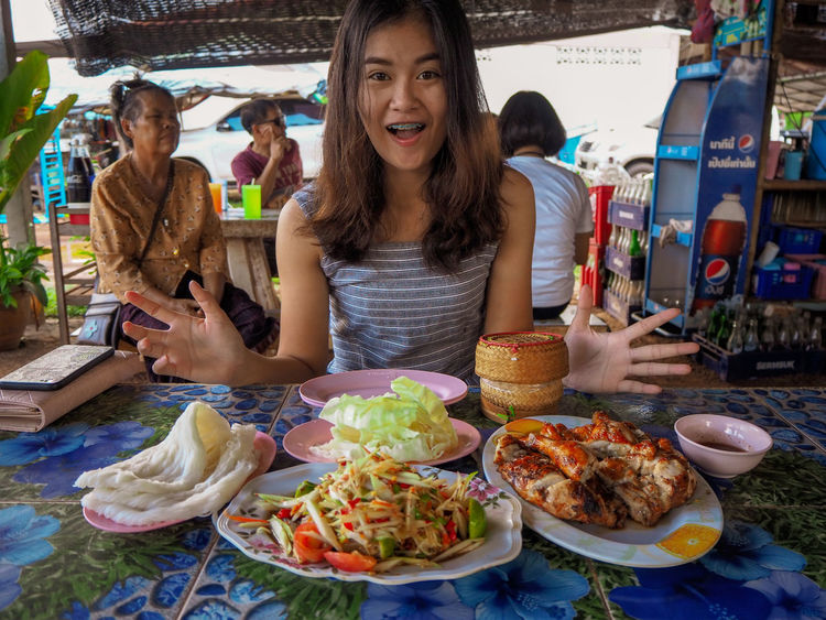Thailand street food. Thailand Street Foods Portrait Friendship Looking At Camera Young Women Sitting Beach Enjoyment Prepared Food Ready-to-eat Friend Rice
