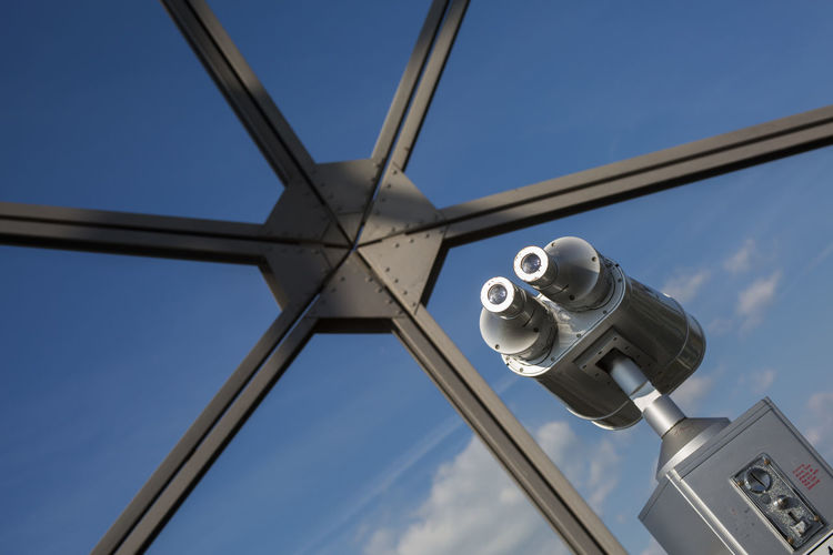 Low angle view of coin-operated binoculars