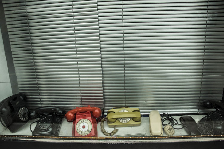 High Angle View Of Rotary Phones In Store