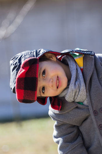 Close-up portrait of cute boy in warm clothing