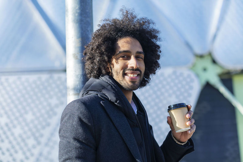 Portrait Of Smiling Man Having Coffee In City