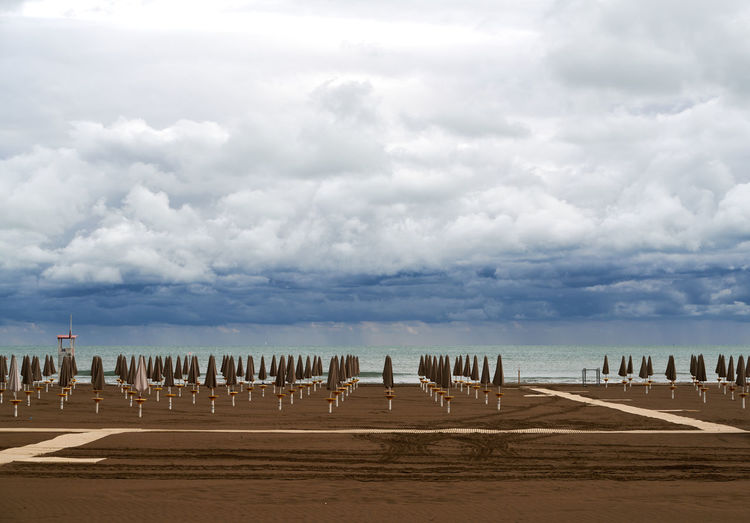 Scenic view of a empty beach against a cloudy sky