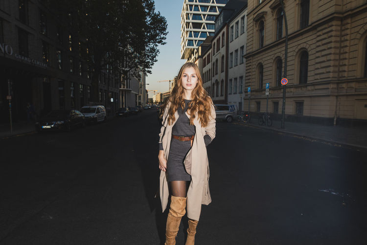 Portrait Of Young Woman On Road In City