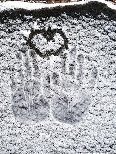 Heart Shape Hand Prints Snow Covered Rock Pattern Close-up My Best Photo