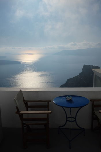 Santorini, Greece Beauty In Nature Blue Chair Day Horizon Horizon Over Water Luxury No People Outdoors Place Setting Santorini Scenics Sea Sea And Sky Sky Sun Table Tranquility Water