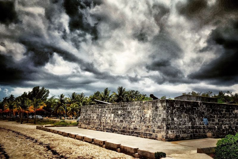 Storm over Fort Montagu, Nassau, Bahamas Nassau, Bahamas Cannon Fort Montagu Clouds Storm Clouds Coconut Trees Beach Shore Fort Stormy Weather Storm