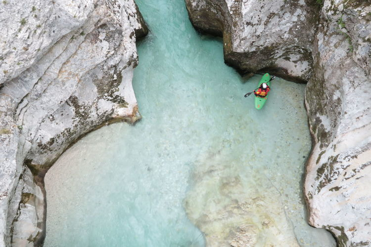 High Angle View Of Man Kayaking Amidst Rock Formations