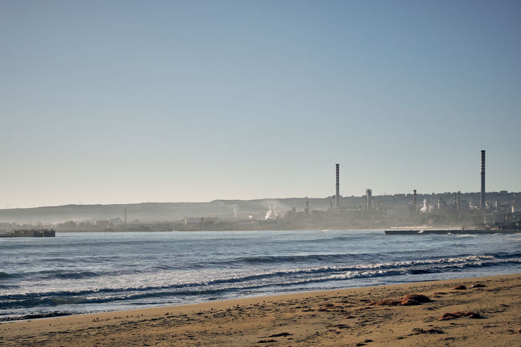 Beach Clear Sky Day Factory Industry Nature No People Outdoors Sea Sky Smoke Stack Water Wave