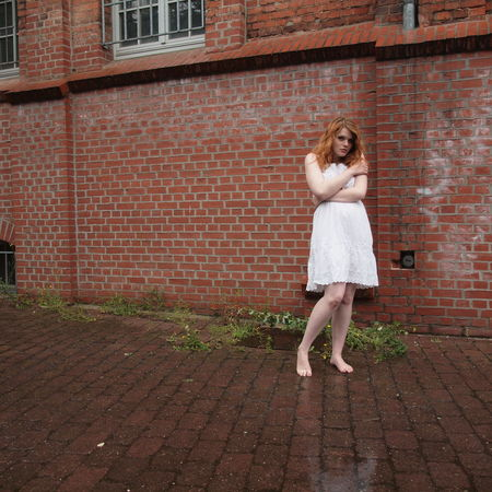 Alone Backyard Barefoot Casual Clothing Cold Freezing Full Length Girl Lonely Rain Real People Standing Sullen Summerdress Wet White Woman Young Adult Young Women