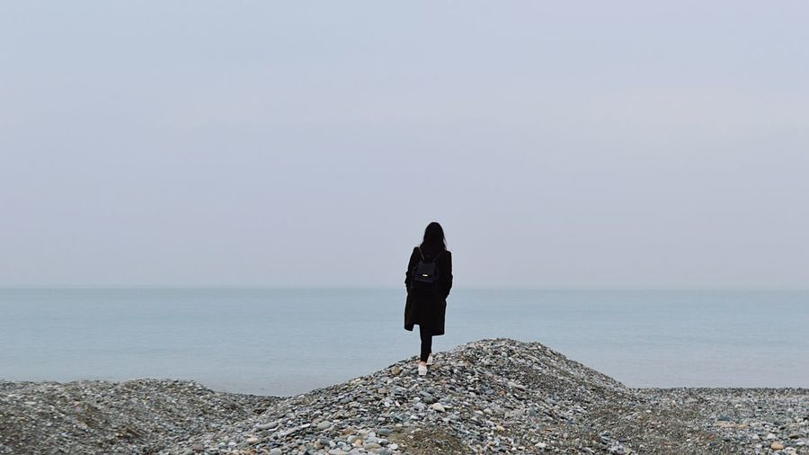Sea Real People Water Rear View Sky Horizon Over Water Horizon Standing One Person Full Length Leisure Activity Beauty In Nature Lifestyles Women Scenics - Nature Day Nature Adult Outdoors Looking At View