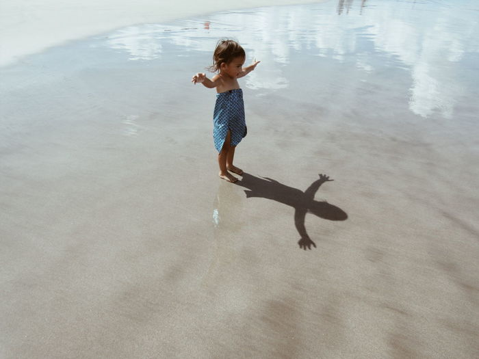 Child Beach Imagine Fly Cloud Reflections In The Water Open Arms Nature Holiday Water Sand High Angle View Beach Shore Sandy Beach Seaside Ankle Deep In Water
