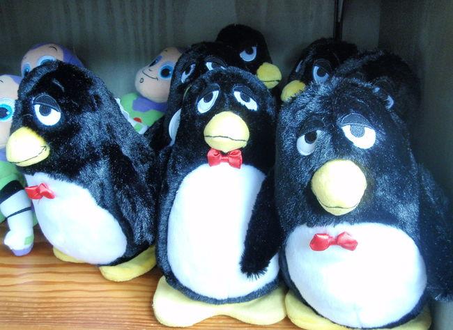 Close-up Dolls Multi Colored Penguin Red Tie Sad Face Shelf Store Toys