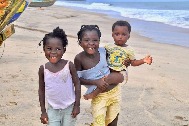 Portrait of happy kids on beach