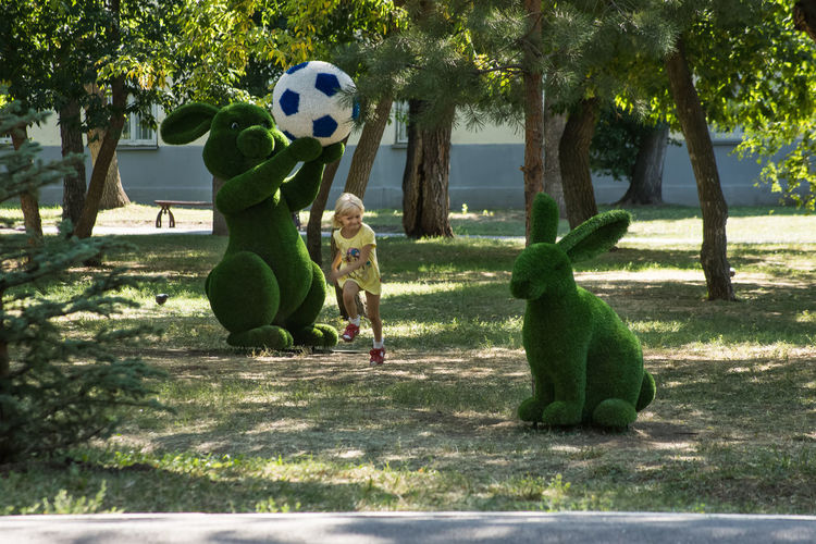 Childhood Tree Boys Soccer Day Child Soccer Ball Outdoors Children Only Shadow Sunlight Full Length Playing One Person Males  One Boy Only People Court Beauty Light Beauty In Nature Nature Tree Branch Green Color