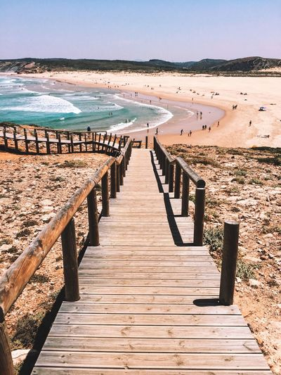 Sommergefühle Water Sand Beach Sea Scenics Wood - Material Day Tranquility Beauty In Nature Tranquil Scene Nature Sunny Clear Sky No People Landscape Outdoors The Way Forward Travel Destinations Vacations Blue Algarve Portugal Ocean Been There. Lost In The Landscape