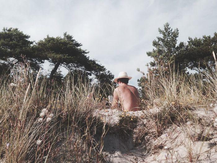 Man Reading A Book Beach Nature Hat