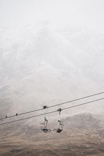 Ski lift against mountain