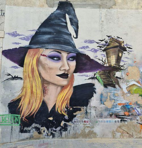 Graffiti sculpture on wall