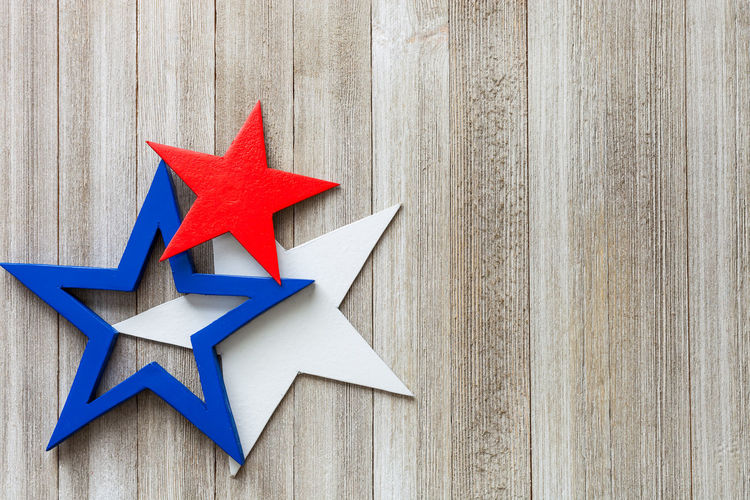Independence Day with red, white and blue stars 4th Of July Celebration Democracy USA America Art And Craft Blue Close-up Constitution Craft Creativity Decoration Design Independence Day Red Red, White And Blue Shape Sign Star Shape Symbol Symbolism Table White Color Wood - Material