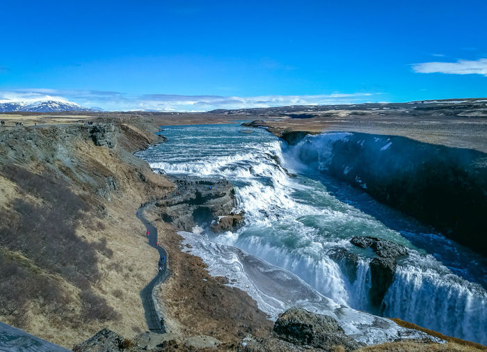 Waterfall Gullfoss Tranquility Calm Blue Water Clouds And Sky No People Beautiful Destinations Outdoors River Blue Sky Blue Water Blue Sky Water Blue Power In Nature Sky Landscape Tranquil Scene Stream Scenics Horizon Over Water Non-urban Scene Idyllic Flowing Water Flowing Natural Landmark