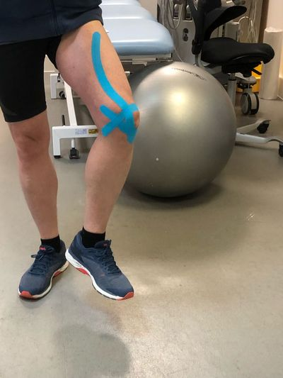 Kinesiology treatment Physiotherapy Knee Injury EyeEm Selects Low Section One Person Human Body Part Human Leg Body Part Sport Lifestyles Sports Equipment Real People Physical Activity Shorts Adult Limb Indoors  Standing