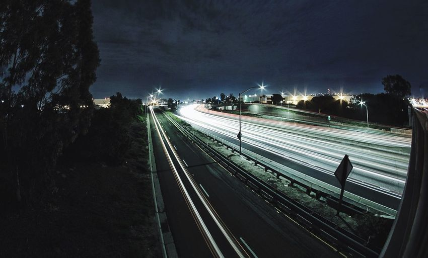 High Angle View Of Light Trails On Railroad Track At Night
