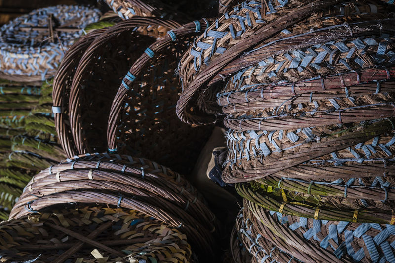 Close-up of stacked wicker baskets for sale