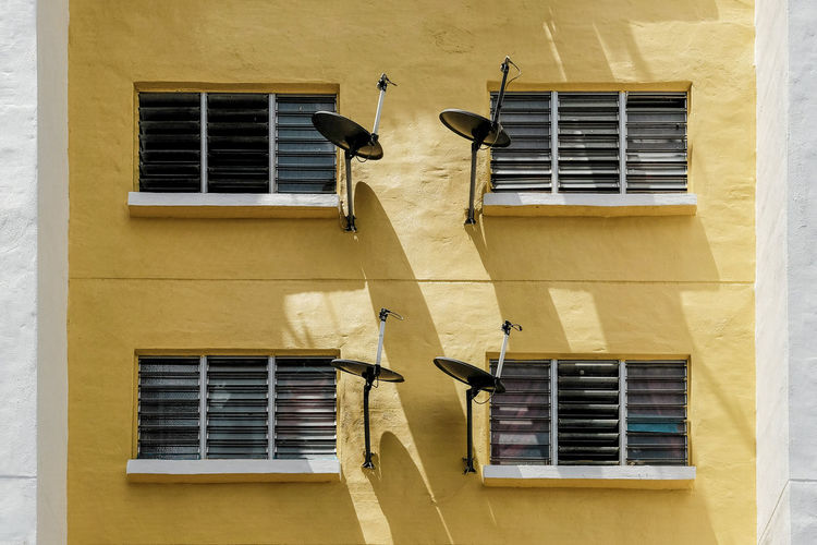 Urban Jungle - Low Cost Residential Apartment The Architect - 2018 EyeEm Awards Apartment Architecture Building Exterior Built Structure Glass Low Angle View No People Residential District Satellite Dishes Window Yellow