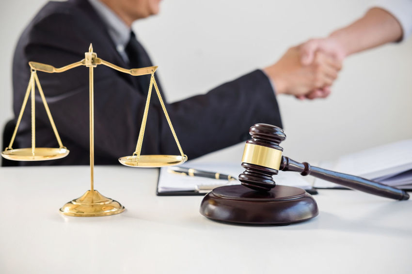 Lawyer Balance Barrister Business Business Person Consultant Fairness Focus On Foreground Front View Gavel Hand Handshake Holding Indoors  Judge Judgement Law Legal Legal System Males  Men Occupation Shaking Hands Sitting Verdict