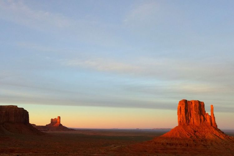 Sunset sunlight illuminating Monument Valley. The KIOMI Collection Butte Landscape Navajo Nation Stone Structures Red Rocks  Monoliths Arid Landscape Arid Climate Sunset Prismatic Rainbow Sky Stone Sand Desert Landscape Desert Sunset Beautiful Nature Nature Arizona Utah Monument Valley