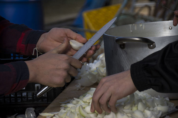 Cropped image of people preparing food