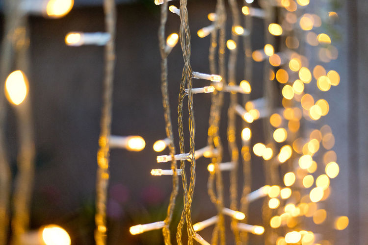 Rope line abstract background with fairy lights Illuminated Lighting Equipment Night Glowing Close-up No People Focus On Foreground Electricity  Decoration Selective Focus Light - Natural Phenomenon Light Electric Light Outdoors Christmas Lights Nature Lens Flare Celebration Defocused Metal Bokeh Lights