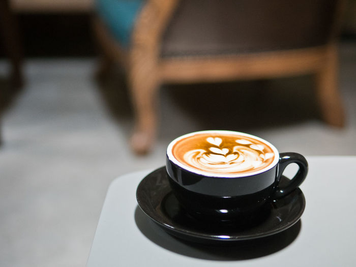 Selective focus on a cup of latte with art design with out of focus background of rustic themed cafe. Architecture Beverage Breakfast Business Caffeine Espresso Latte Aroma Cafe Cappuccino Coffee Coffee - Drink Coffee Cup Crockery Cup Drink Enjoying Life Food And Drink Frothy Drink Frothymilk Kickstart Milk Mug Refreshment Relax